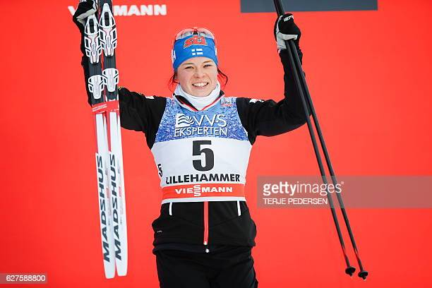 Third placed Krista Parmakoski of Finland poses on the podium after the women's 10km Cross Country pursuit event at the FIS Cross Country World Cup...
