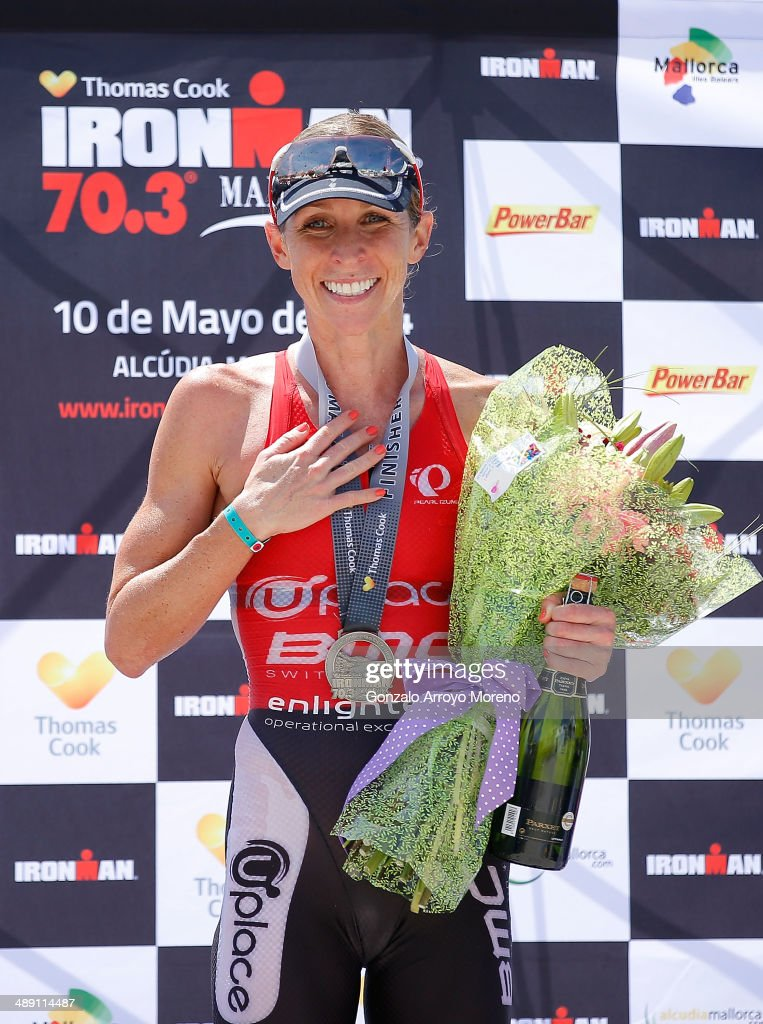 Third placed Liz Blatchford celebrates on the podium after finishing the Ironman 70.3 Mallorca on May 10, 2014 in Mallorca, Spain.
