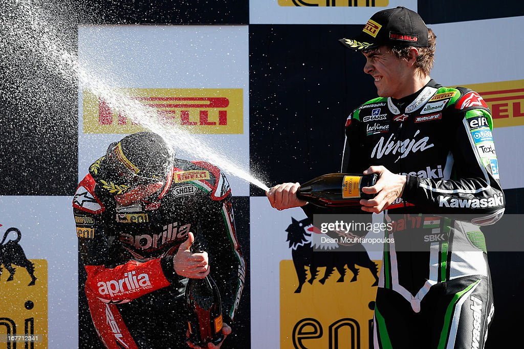 Third placed, Loris Baz (R) of France (#76) on the Kawasaki ZX-10R for Kawasaki Racing Team sprays first placed, <a gi-track='captionPersonalityLinkClicked' href=/galleries/search?phrase=Eugene+Laverty&family=editorial&specificpeople=4253466 ng-click='$event.stopPropagation()'>Eugene Laverty</a> (#58) of Ireland on the Aprilia RSV4 for the Aprilia Racing Team on the podium after the World Superbikes Race 2 at TT Circuit Assen on April 28, 2013 in Assen, Netherlands.