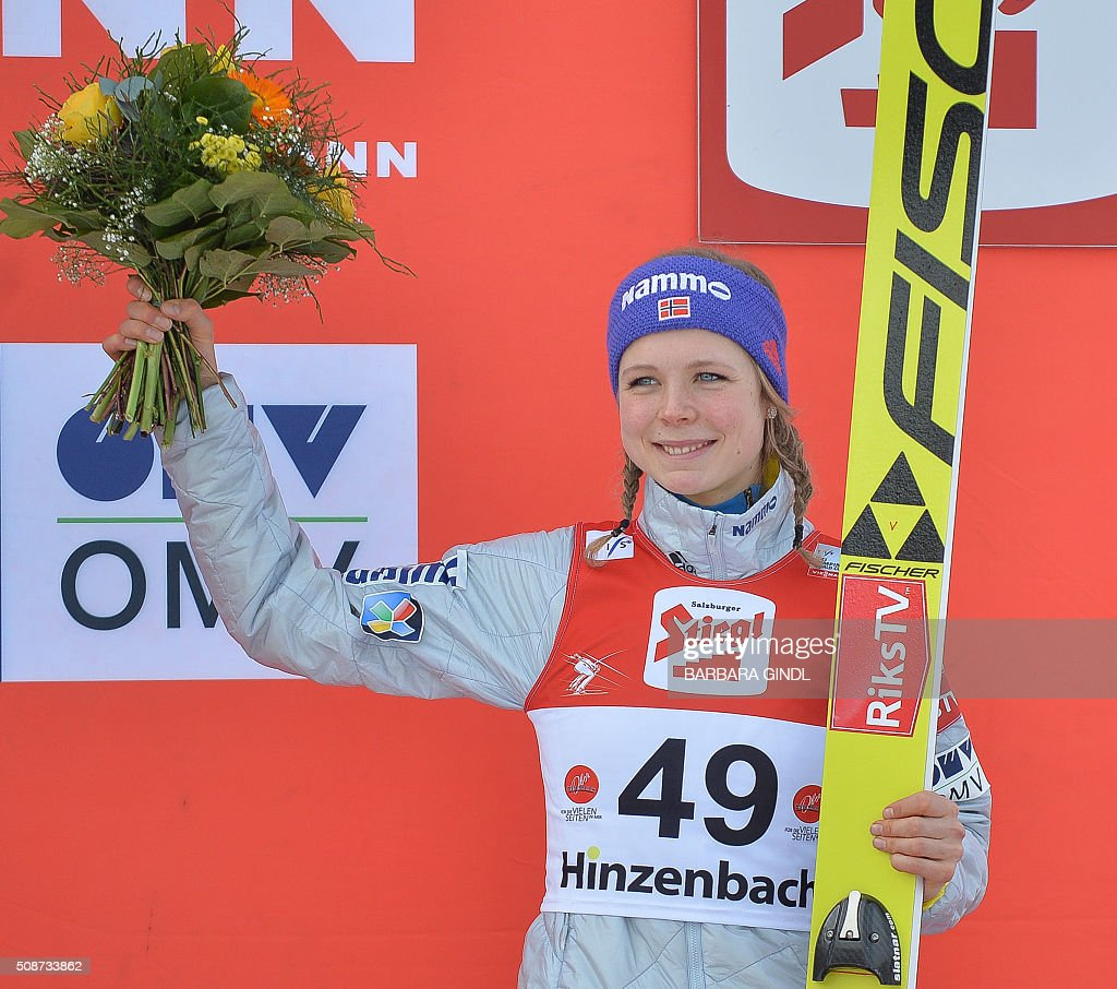 Third placed Maren Lundby of Norway poses on the podium after the women's ski jumping world cup in Hinzenbach, Upper Austria on February 6, 2016. / AFP / APA / BARBARA GINDL / Austria OUT