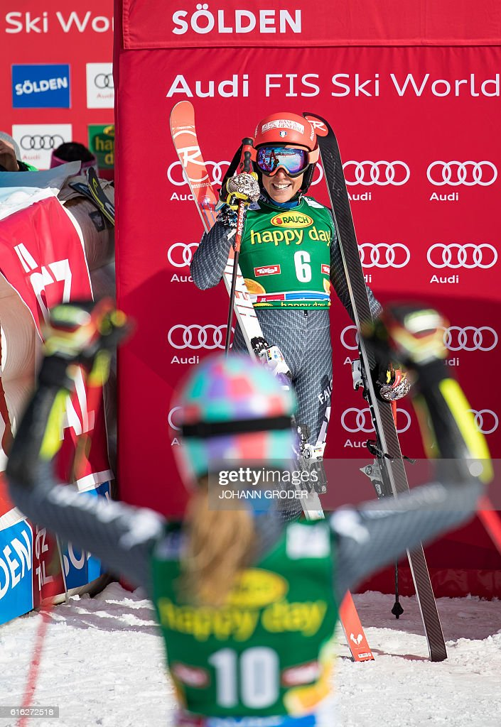 Third placed Marta Bassino of Italy (front) and Federica Brignone of Italy react after the second run of the ladies' giant slalom of the FIS ski world cup in Soelden, Austria on October 22, 2016. / AFP / APA / Johann GRODER / Austria OUT