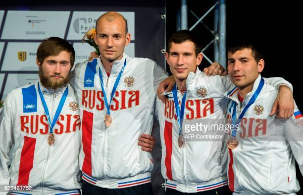 Third placed Russian Anton Glebko Sergey Khodos Nikita Glatzkov and Pavel Sukhov stand on the podium after the team men's epee competition at the...