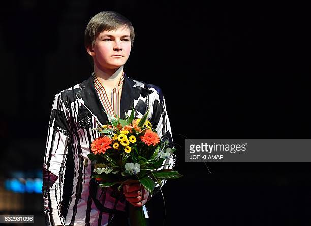 Third placed Russia's Mikhail Kolyada poses with his medal during the winners ceremony of the men's free skating competition of the European Figure...