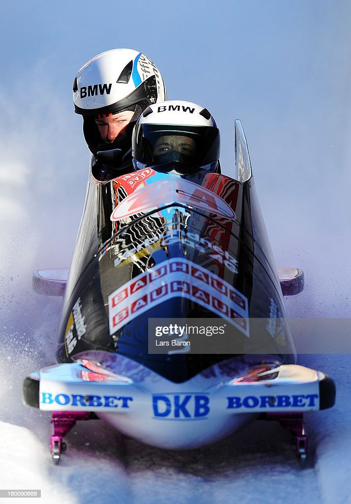 Third placed Sandra Kiriasis and Franziska Bertels celebrate after the Women's Bobsleigh final heat of the IBSF Bob Skeleton World Championship at...