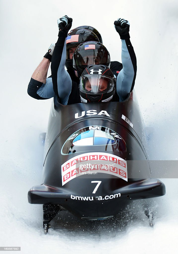 Third placed Steven Holcomb, Justin Olsen, Steven Langton and Curtis Tomasevicz of USA celebrate after the Four Men Bobsleigh final heat of the IBSF Bob & Skeleton World Championship at Olympia Bob Run on February 3, 2013 in St Moritz, Switzerland.
