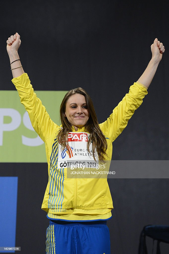 Third placed Sweden's Erica Jarder celebrates on the podium after the women's Long Jump final at the European Indoor athletics Championships in Gothenburg, Sweden, on March 2, 2013. AFP PHOTO / JONATHAN NACKSTRAND
