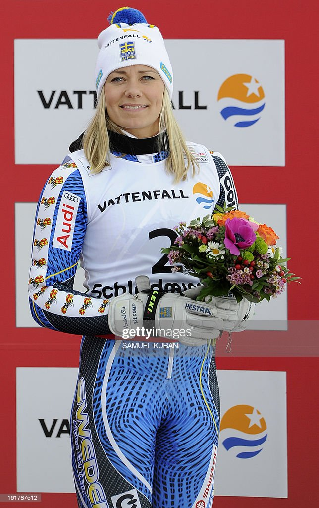 Third placed Sweden's Frida Hansdotter smiles on the podium after the women's slalom at the 2013 Ski World Championships in Schladming, Austria on February 16, 2013.