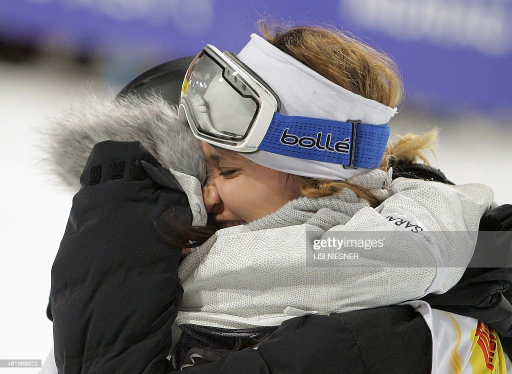Third placed Switzerland's Mirjam Jaeger (R) hugs her compatriot first placed <a gi-track='captionPersonalityLinkClicked' href=/galleries/search?phrase=Virginie+Faivre&family=editorial&specificpeople=786060 ng-click='$event.stopPropagation()'>Virginie Faivre</a> after the Women's Ski Halfpipe Finals of FIS Freestyle and Snowboarding World Ski Championships in Kreischberg, Austria on January 22, 2015.