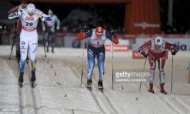 Third placed Teodor Peterson of Sweden second placed Anton Gafarov of Russia and winner Eirik Brandsdal of Norway in action during men's cross...