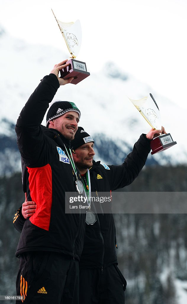 Third placed Thomas Florschuetz and Andreas Bredau of Germany pose after the Two Men Bobsleigh final heat of the IBSF Bob & Skeleton World Championship at Olympia Bob Run on January 27, 2013 in St Moritz, Switzerland.
