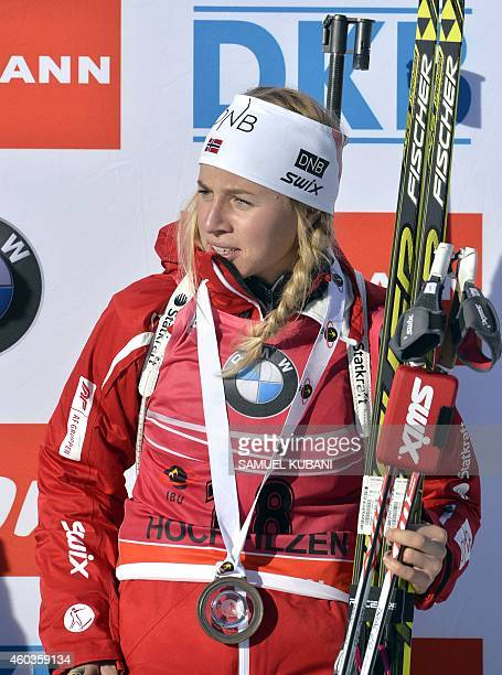 Third placed Tiril Eckhoff of Norway poses on the podium after the women 75 km sprint at the IBU Biathlon World cup in Hochfilzen on December 12 2014...
