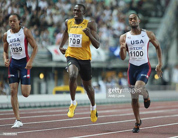 Third placed Wallace Spearmon of the United States of America second placed Usain Bolt of Jamaica and race winner Tyson Gay of the United States of...