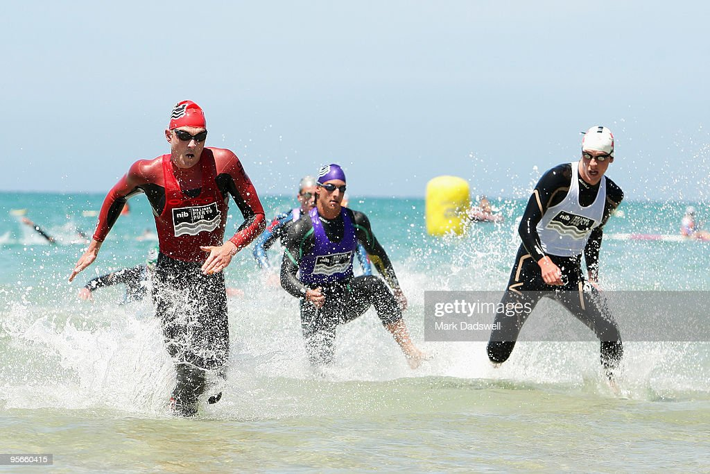 Third placegetter Riley Schmidt leads out of the water but was then beaten by Jack Hansen and Elite Mens winner Sam Sheppard during the Lorne Pier to...