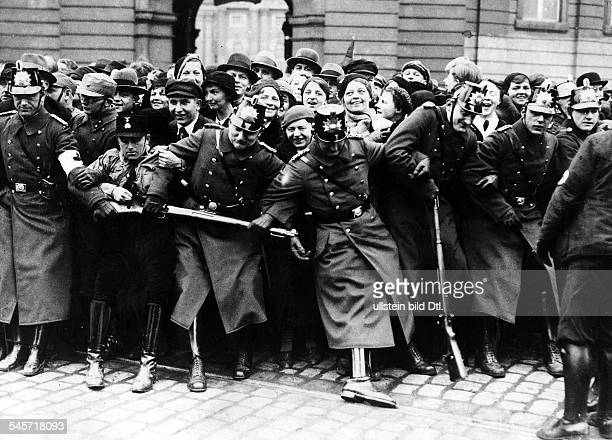 Third Reich opening of the Reichstag 'Day of Potsdam' Policemen as well as members of SA and SS try to push back the enthusiastic crowd