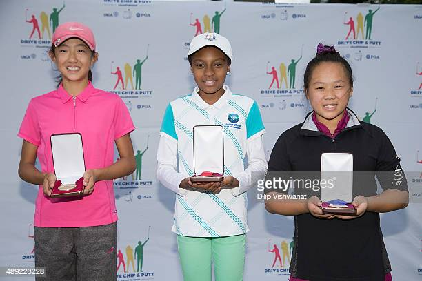 Third second and first place winners in the putting contest Stephanie Su Reese Wilson and Airel Chang photographed during the 2015 Drive Chip and...
