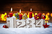 third sunday in advent concept xmas light wooden background with candles ball bauble stars