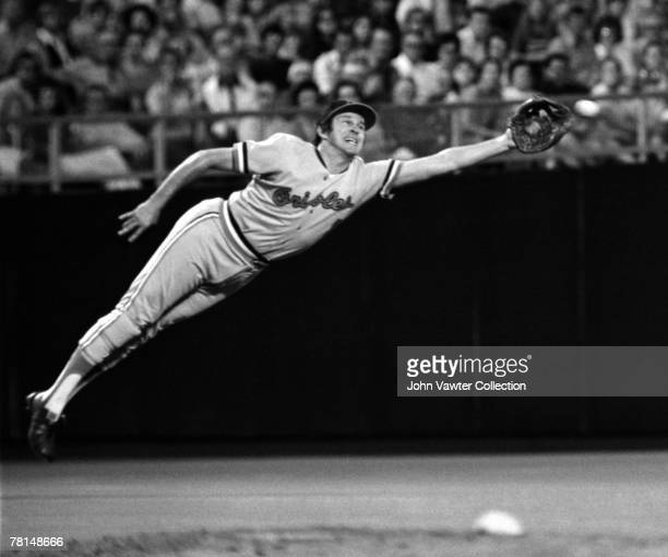 Thirdbaseman Brooks Robinson of the Baltimore Orioles dives attempting to snag the line drive hit by Amos Otis of the Kansas City Royals in the third...
