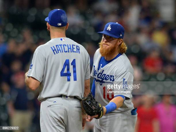 Thirdbaseman Justin Turner of the Los Angeles Dodgers stands with pitcher Chris Hatcher as Hatcher exits the game in the ninth inning of a game on...