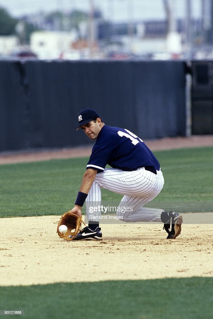 Thirdbaseman Mike Lowell of the New York Yankees backhands a ground ball during workouts prior to a Spring Training game in March 1998 at the...