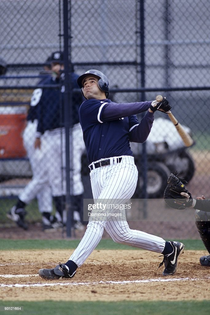 Thirdbaseman Mike Lowell of the New York Yankees swings at a pitch during a Spring Training game in March 1998 at the Yankees' minor league complex...