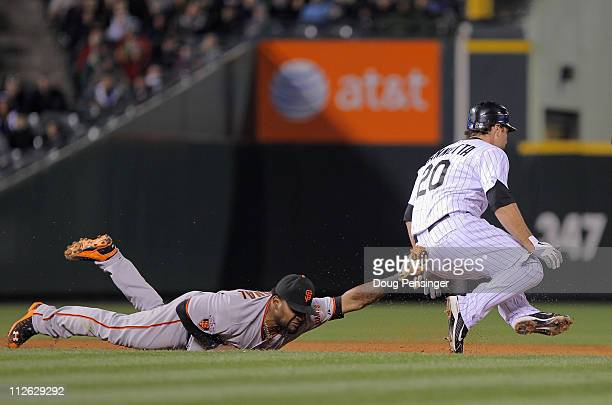 Thirdbaseman Pablo Sandoval of the San Francisco Giants tags out Chris Iannetta of the Colorado Rockies for the final out of the fifth inning at...