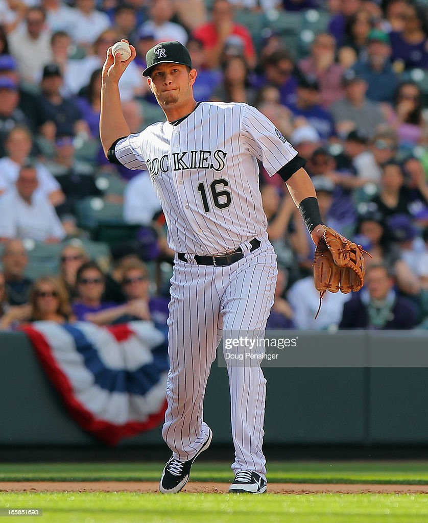 Thirdbaseman <a gi-track='captionPersonalityLinkClicked' href=/galleries/search?phrase=Reid+Brignac&family=editorial&specificpeople=4175431 ng-click='$event.stopPropagation()'>Reid Brignac</a> #16 of the Colorado Rockies throws out a runner against the San Diego Padres during Opening Day at Coors Field on April 5, 2013 in Denver, Colorado. The Rockies defeated the Padres 5-2.