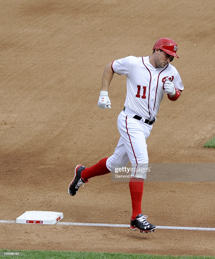 Thirdbaseman Ryan Zimmerman #11 of the Washington Nationals circles the bases after hitting a solo homerun off pitcher Cliff Lee of the Philadelphia Phillies leading off the bottom of the fourth inning of a game on October 3, 2012 at Nationals Park in Washington, DC. The Nationals beat the Phillies, 5-1 and clinched home field advantage throughout the post season.