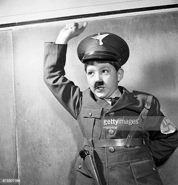 A thirdgrade child impersonating Adolf Hitler during a school play at The Lincoln School of Teachers' College Columbia University New York New York...