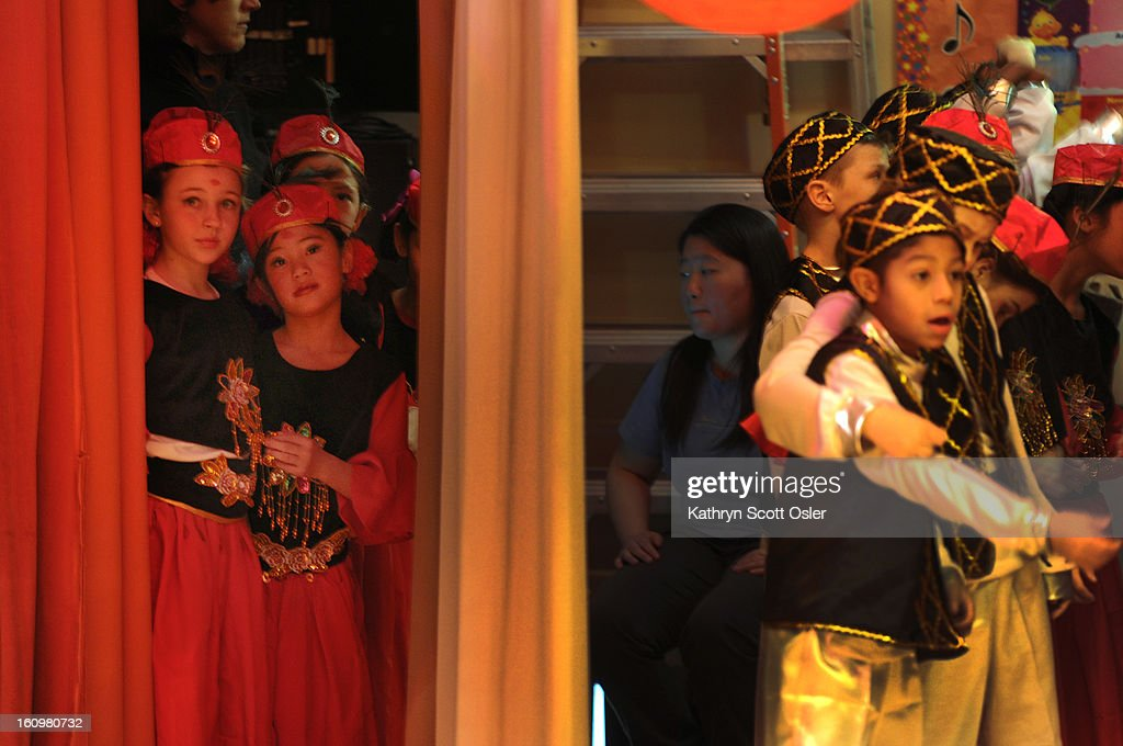 Third-graders Alejandra Cole, 8, left, and Avery McLaughlin, 8, second from left, wait backstage with their classmates ready to perform the Xinjiang (Uyghur ) Dance. Students at the Denver Language School ring in the Year of the Snake with their Chinese New Year celebration performance in the school auditorium. Kindergarteners through 4th grade perform traditional dances dressed in colorful Chinese costumes. According to the school principal, Chinese New Year is the most important of the traditional Chinese holidays. Families make way for good luck by cleaning their homes symbolizing reconciliation and forgetting old grudges in exchange for peace and happiness. The Chinese New Year (Feb. 10) follows the Chinese 12 Zodiac Calendar Year designating 2013 the Year of the Snake.