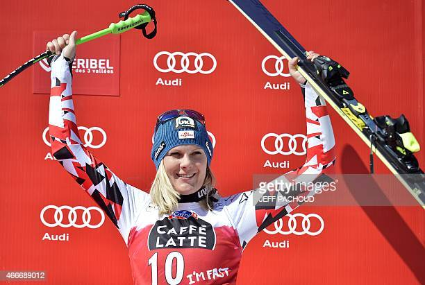 Thirdplaced Austria's Nicole Hosp celebrates on the podium of the Women's downhill at the FIS Alpine Skiing World Cup finals in Meribel on March 18...