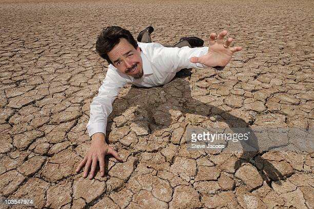 Thirsty Man in Desert
