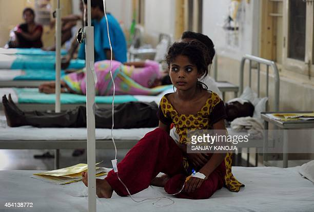 Thirteen yearold Indian girl Preeti sits on a bed in the Janki Kund Hospital following a stampede at the Kamta Nath Temple in Chitrakoot district of...