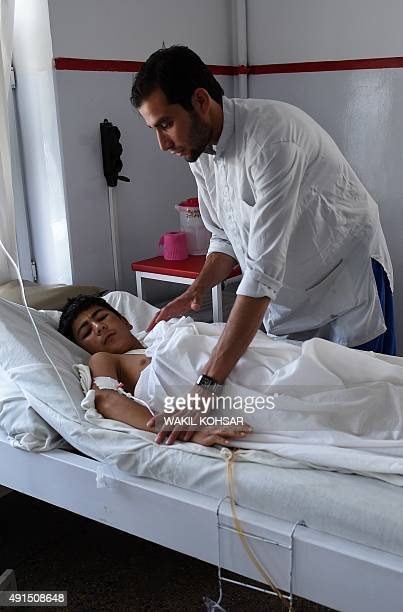 Thirteen yearold wounded Afghan boy Nooruddin a survivor of the US airstrikes on a Doctors Without Borders Hospital in Kunduz receives treatment at...