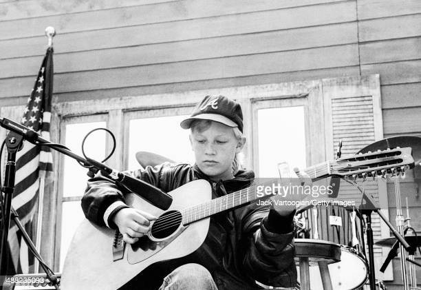 Thirteenyearold American musician Derek Trucks plays slide guitar in a 'Youngbloods' set of upandcoming blues and bluesrock musicians on the Front...