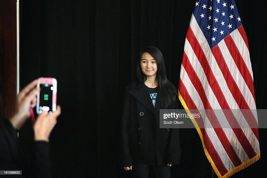 Thirteen-year-old Andrea Adap from the Philippines poses for a picture next to an American flag after she received a citizenship certificate during a ceremony at the Chicago Cultural Center on February 12, 2013 in Chicago, Illinois. The ceremony was held to recognize as new U.S. citizens 62 children, ages 6-18, from 23 countries who were adopted from abroad or who derived U.S. citizenship when their immigrant parents were naturalized.
