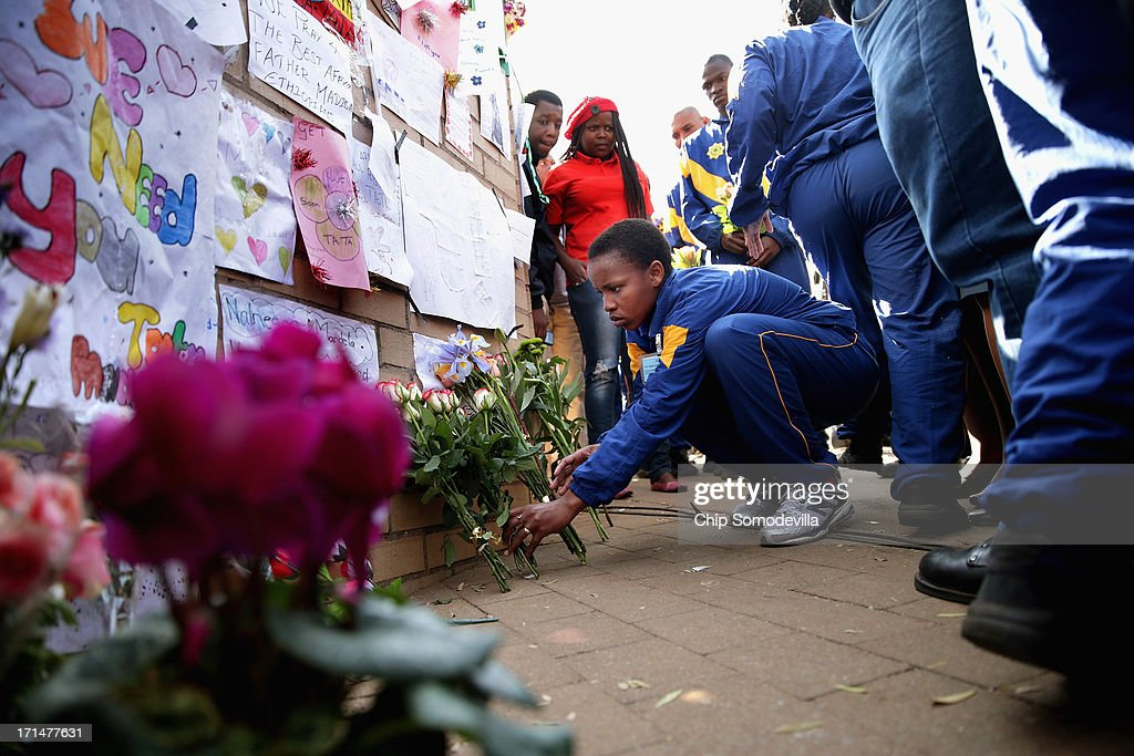 Thirty six South African Police Academy trainees leave flowers for former South African President Nelson Mandela outside the Mediclinic Heart Hospital June 25, 2013 in Pretoria, South Africa. South African President Jacob Zuma confirmed Sunday that Mandela's condition has become critical since he was admitted to the hospital over two weeks ago for a recurring lung infection.