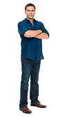 Thirtyish Casual Man on White Background. Shirt untucked, sleeves rolled up, arms crossed
