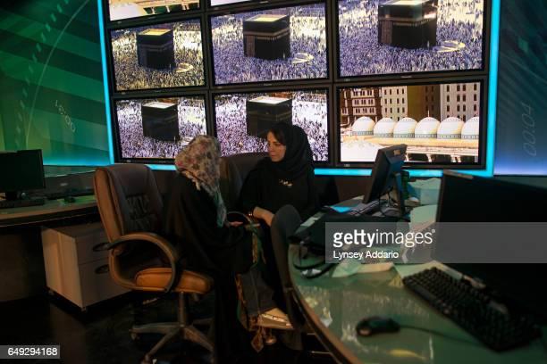 Thirtyoneyearold Reem Dokhan talks with Ranim Qubbaj under live images of Mecca at the Ministry of Information in Riyadh Saudi Arabia Feb 27 2013...