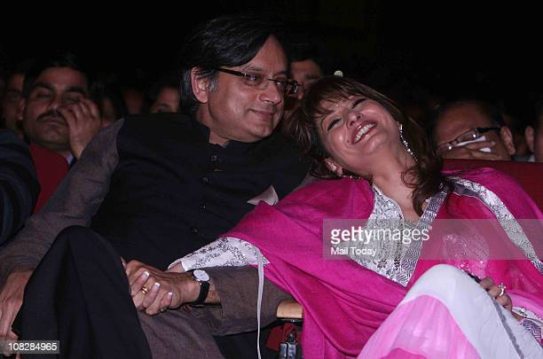 Thiruvananthapuram MP Shashi Tharoor and his wife Sunanda get into the spirit of the evening In their romantic moments during Asha Bhonsle and Amit...
