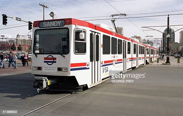 This 01 February 2001 photo shows a newly built lightrail train as it moves through Salt Lake CityUT The train system will be used for transportation...