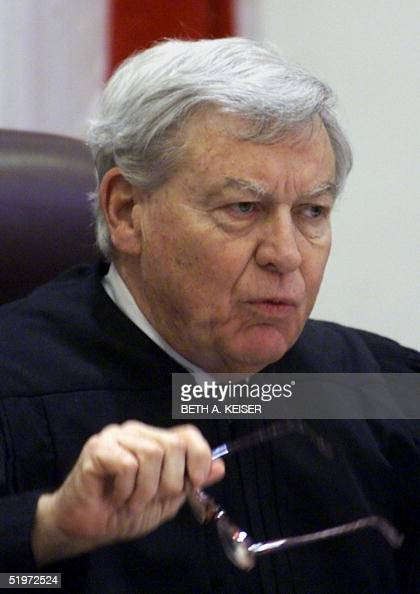 This 07 December 2000 photo shows Florida Chief Justice Charles T Wells in Tallahassee Florida The Florida Supreme Court decided in a 43 vote 08...