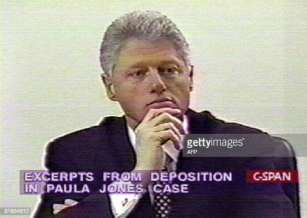 This 10 December image taken from CSpan television shows US President Bill Clinton giving videotaped sworn deposition in tha Paula Jones sexual...
