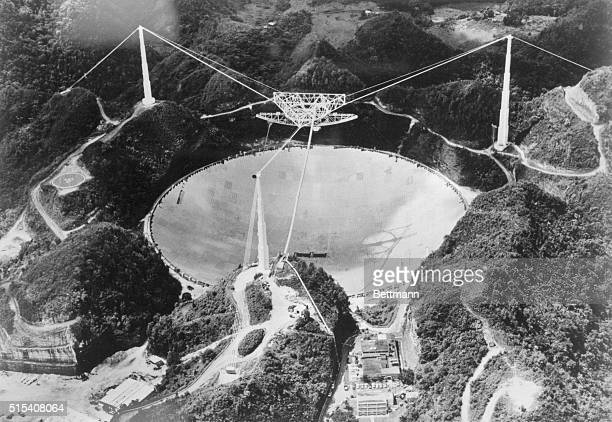 This 1000 foot curved 'dish' in the hills of Puerto Rico is the world's largest telescope The Arecibo Observatory which went into operation in 1963...