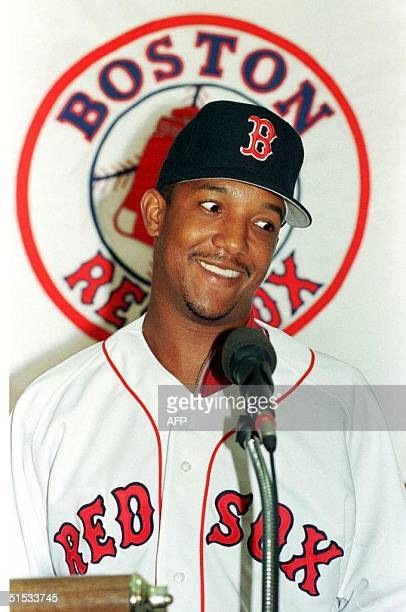 This 12 December 1997 file photo shows Boston Red Sox ace pitcher Pedro Martinez addressing a press conference in Boston after the club signed him...