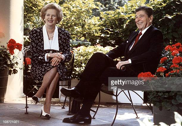 This 17 July 1987 file photo shows former US President Ronald Reagan and former British Prime Minister Margaret Thatcher as they pose for...