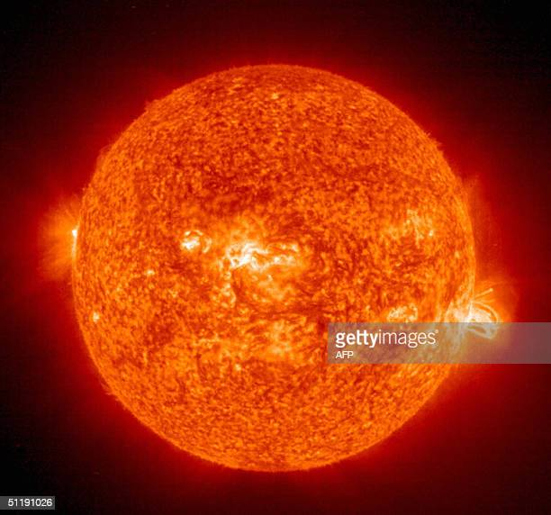 This 19 August 2004 NASA Solar and Heliospheric Administration image shows a solar flare erupting from giant sunspot 649 The powerful explosion...