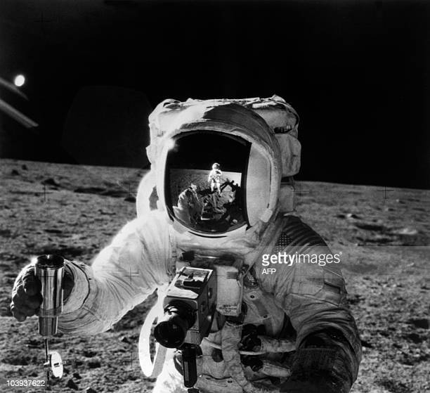 This 19 November 1969 file photo released by NASA shows one of the astronauts of the Apollo 12 space mission conducting experiment on the moon's...