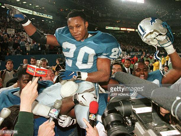 This 21 December 1997 file photo show Detroit Lions Barry Sanders as he is carried off of the field by his teammates after he became one of three...