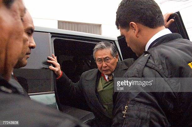 This 22 September 2007 file photo shows former Peruvian president Alberto Fujimori getting out of a vehicle helped by Interpol officers upon his...
