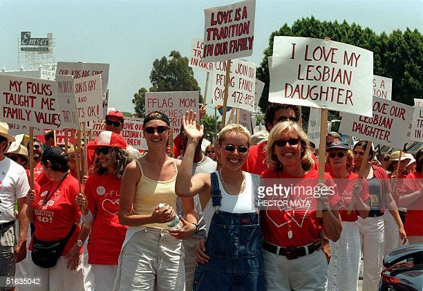 This 28 June 1998 file photo shows a group of lesbian and gay activists demonstrating during a parade in North Hollywood California Gay activists...